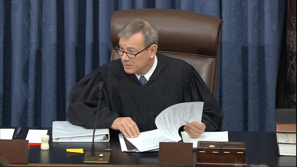 Presiding officer Supreme Court Chief Justice John Roberts at the impeachment trial against President Trump in the Senate at the U.S. Capitol on Tuesday. Roberts' role moderating the trial isn't explicitly clear from the Constitution but a law professor at Georgetown Law says that, in the absence of specific guidelines, Roberts could help guide where the trial goes.