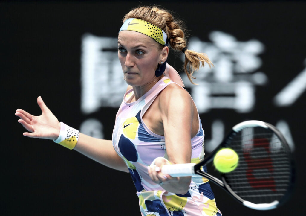 Petra Kvitova of the Czech Republic makes a forehand return to Spain's Paula Badosa during their second round singles match at the Australian Open tennis championship in Melbourne, Australia, Wednesday.