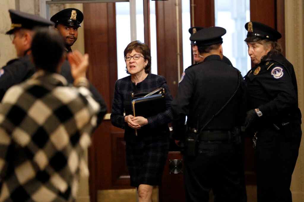Sen. Susan Collins, R-Maine, arrives at the Capitol on Thursday for the impeachment trial of President Trump.