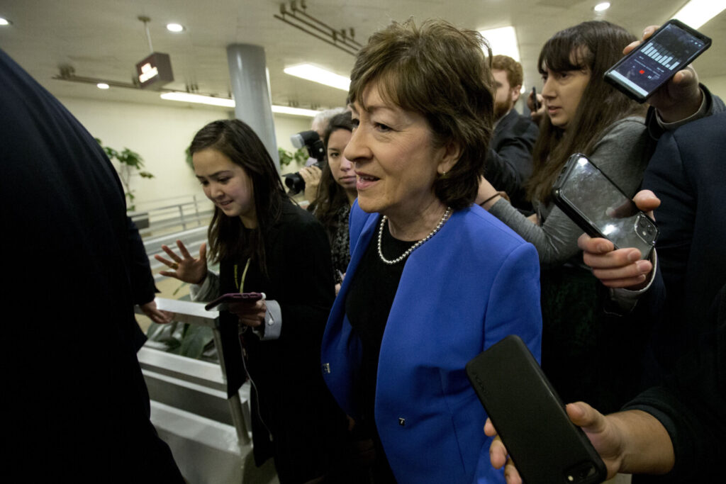Sen. Susan Collins R-Maine, talks to reporters before attending the impeachment trial of President Trump on Tuesday.