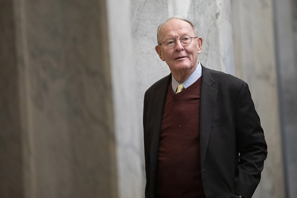 Sen. Lamar Alexander, R-Tenn., arrives on Capitol Hill on Thursday before the impeachment trial of President Trump. He said Thursday night that he would not vote Friday to support calling witnesses in the trial.