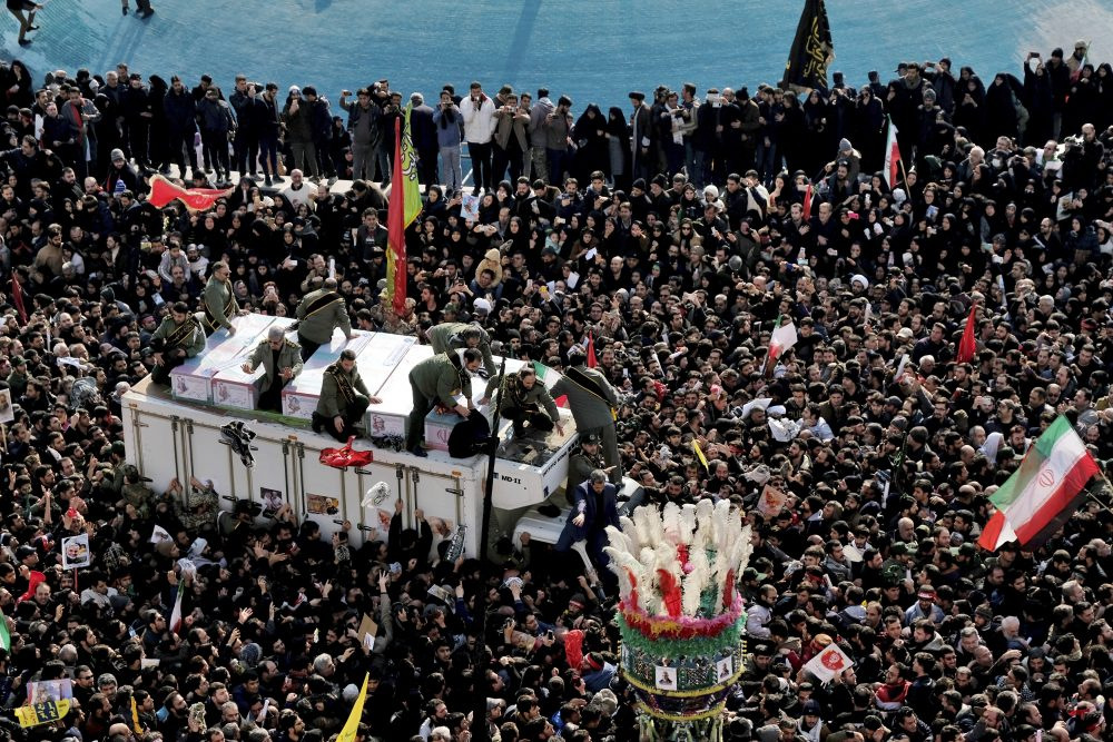 Coffins of Gen. Qassem Soleimani and others who were killed in Iraq by a U.S. drone strike, are carried on a truck surrounded by mourners during a funeral procession at the Enqelab-e-Eslami (Islamic Revolution) square in Tehran, Iran, on Monday. The processions mark the first time Iran honored a single man with a multi-city ceremony. Not even Ayatollah Ruhollah Khomeini, who founded the Islamic Republic, received such a processional with his death in 1989.