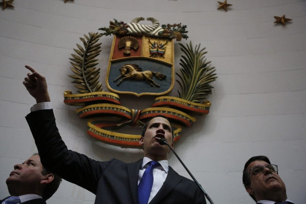 Opposition leader Juan Guaido speaks at the National Assembly in Caracas, Venezuela, on Tuesday. Guaidó and lawmakers who back him, pushed their way into the legislative building on Tuesday following an attempt by rival legislators to take control of the congress, and declared Guaidó the president of the only opposition-controlled institution.