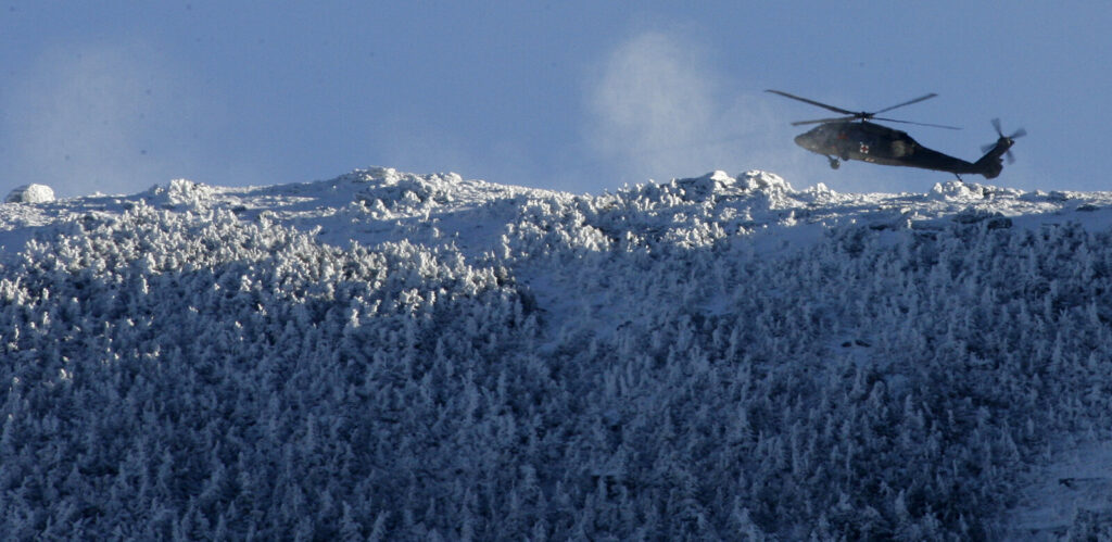 A helicopter flies the ridge line of Mount Lafayette with search and rescue teams during a January 2007 incident in Franconia, N.H. Similarly, a helicopter crew rescued a hiker from Mount Lincoln on Wednesday, after he turned back from trying to summit Mount Lafayette.