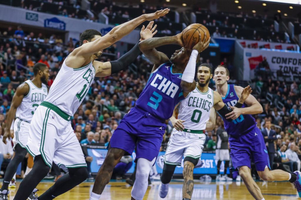 Charlotte's Terry Rozier puts up a shot  over Boston's Enes Kanter during Tuesday's game.  Celtics won 109-92.