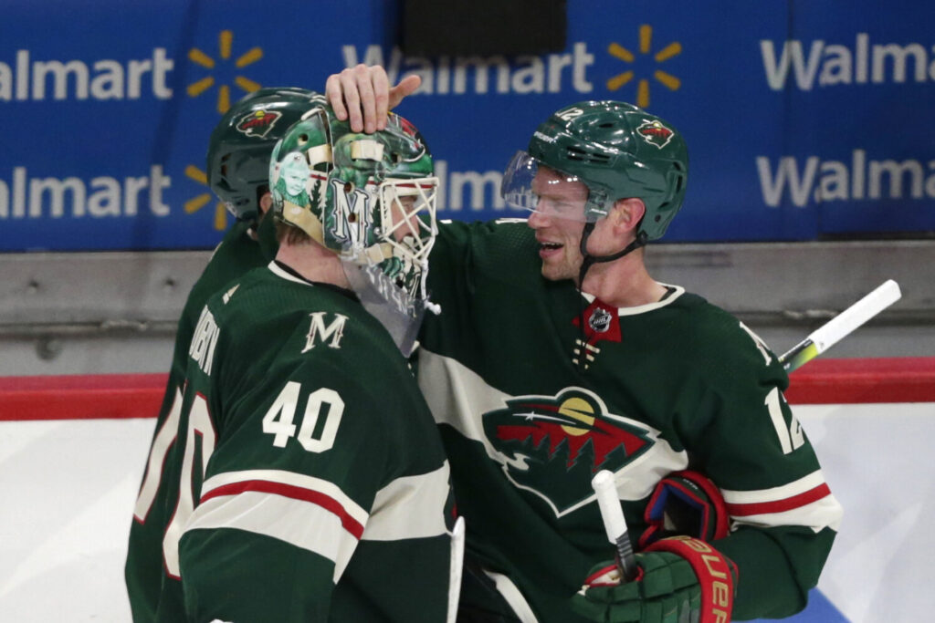 Minnesota Wild center Eric Staal (12) celebrates with Minnesota Wild goalie Devan Dubnyk (40) after defeating the Winnipeg Jets in 3-2 in overtime Saturday in St. Paul, Minn.