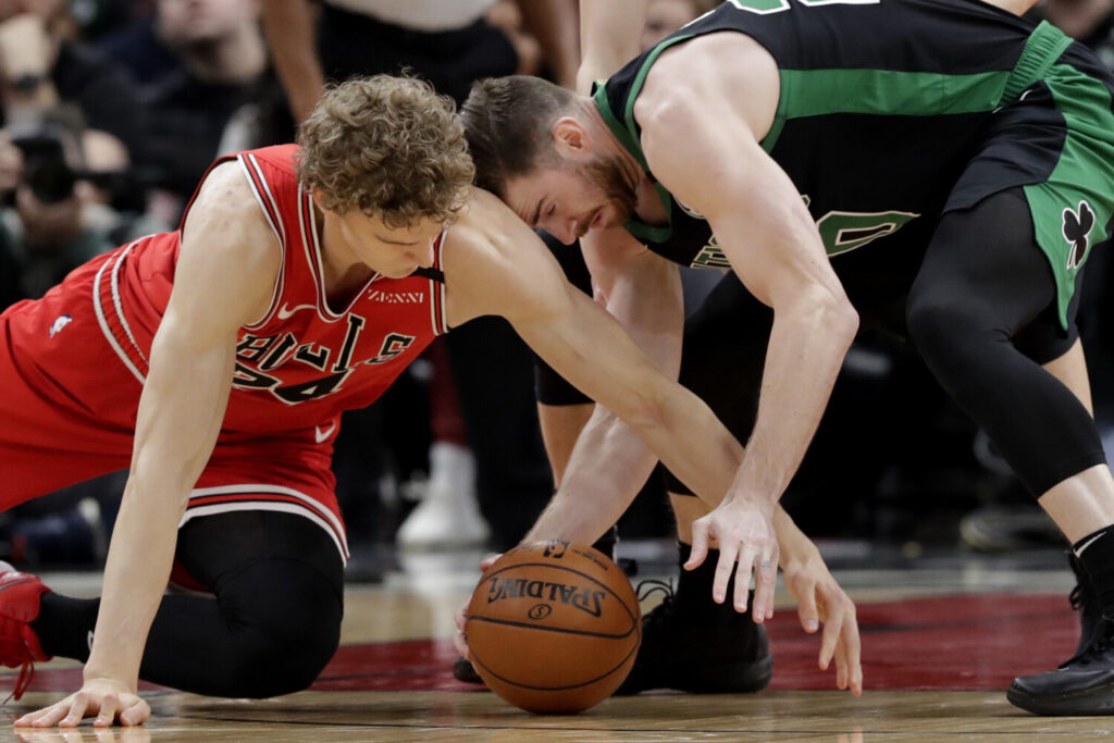 Chicago forward Lauri Markkanen, left, and Boston forward Gordon Hayward compete for the ball during Saturday's game in Chicago