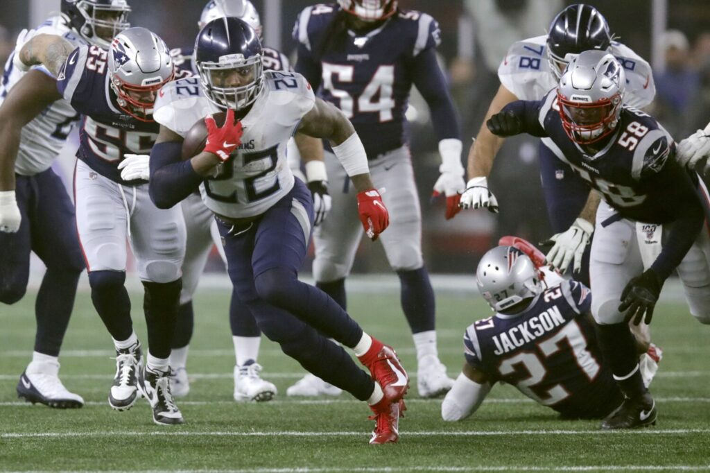 Tennessee running back Derrick Henry rushed for 182 yards and a touchdown as the Titans beat New England 20-13 in an AFC wild-card game, Saturday in Foxborough, Mass.