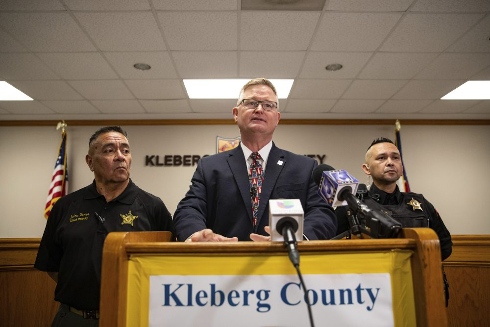 Kleberg County District Attorney John Hubert announces on Wednesday in Kingsville, Texas, that new charges have been filed against Amanda Noverr and Adam Curtis Williams, who were arrested last year in connection with the deaths of a New Hampshire couple found buried at a South Texas beach.