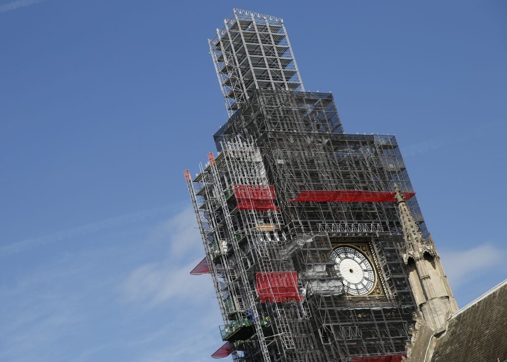 Scaffolding surrounds the Queen Elizabeth Tower, which holds the bell known as Big Ben, in London in 2018. The bell of Britain's Parliament has been largely silent since 2017 while its iconic clock tower undergoes four years of repairs. Brexit-backing lawmakers are campaigning for it to strike at the moment Britain leaves the European Union. Alastair Grant/Associated Press