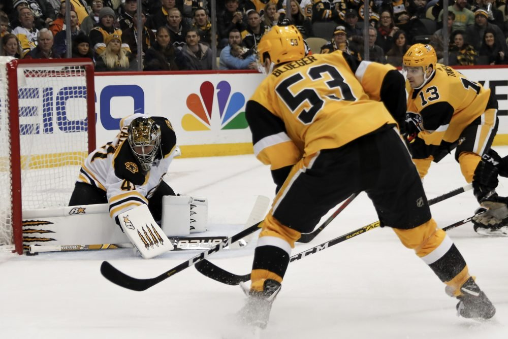 Bruins goaltender Jaroslav Halak keeps the puck out of the net as Pittsburgh's Teddy Blueger (53) and Brandon Tanev look for a rebound during Boston's 4-3 loss on Sunday in Pittsburgh.
