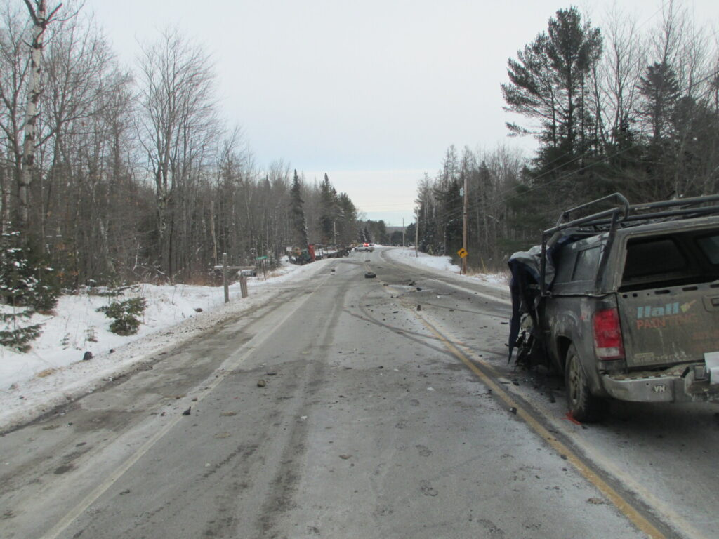 Debris is strewn along Route 2 in Canaan on Saturday morning following a fatal collision between a pickup truck and a pulp truck. According to Somerset County Sheriff's Department, one man was killed and two others were injured.