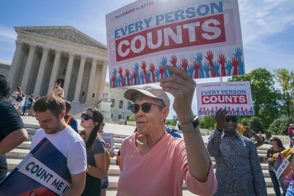 Immigration activists rally outside the Supreme Court as the justices hear arguments over the Trump administration's plan to ask about citizenship on the 2020 census, in Washington on April 23, 2019. The question won't be on the census, but states like Maryland, New York and Alabama are all pursuing citizenship-related court cases.