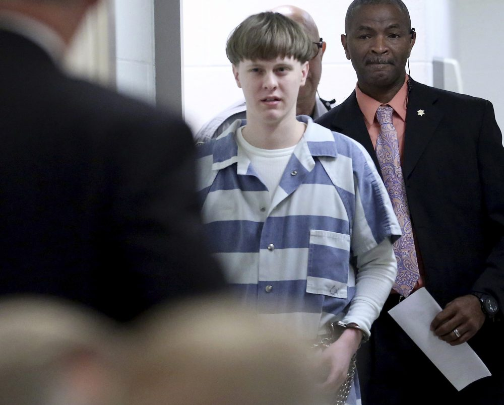 In this April 10, 2017, file photo, Dylann Roof enters the court room at the Charleston County Judicial Center to enter his guilty plea on murder charges in Charleston, S.C.  Roof on Tuesday appealed his federal convictions and death sentence in the 2015 massacre of nine black church members in South Carolina, arguing that he was mentally ill when he represented himself at his capital trial.