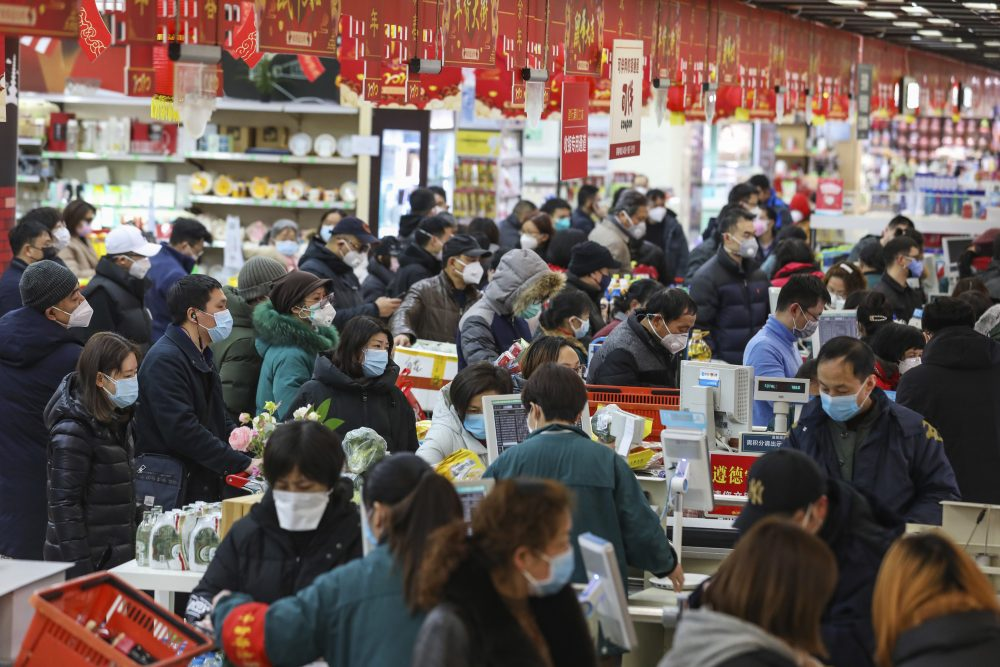 Shoppers pay for their groceries at a supermarket in Wuhan, China, on Saturday.
