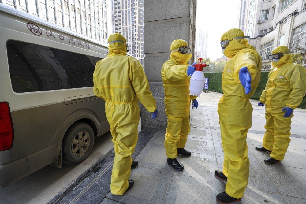 Funeral workers disinfect themselves after handling a virus victim in Wuhan in central China's Hubei Province on Thursday.