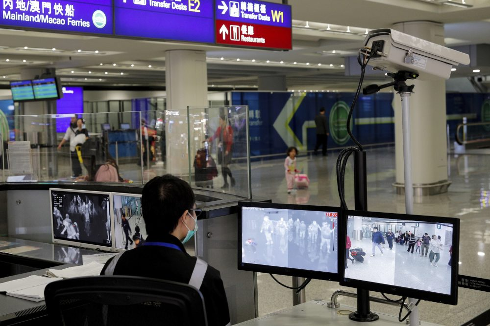A health surveillance officer monitors passengers arriving at the Hong Kong International airport in Hong Kong this month. The U.S. Centers for Disease Control and Prevention says it will begin screen airline passengers at three U.S. airports who traveled from Wuhan in central China, for a new illness that has prompted worries about a new international outbreak.