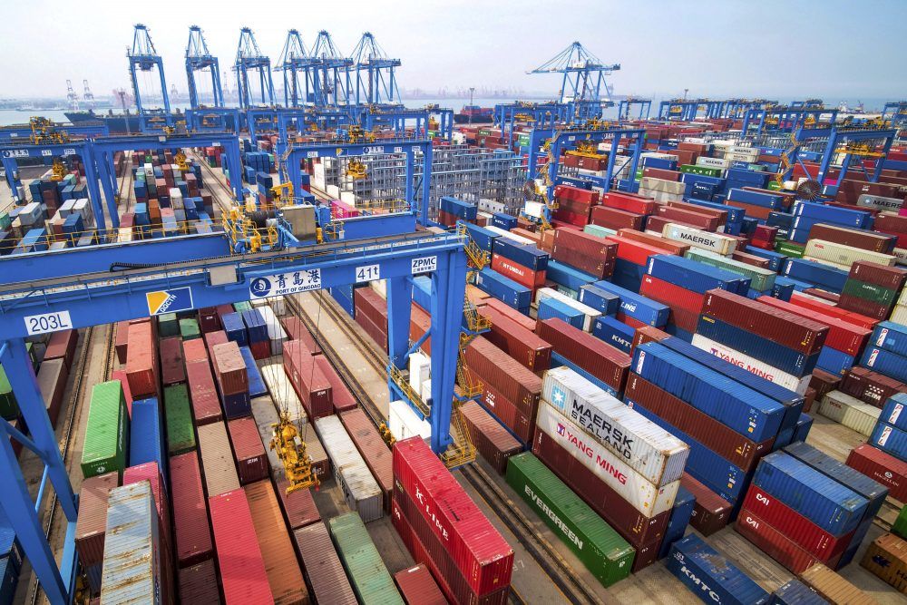 In this Tuesday, May 14, 2019, file photo, containers are piled up at a port in Qingdao in east China's Shandong province.