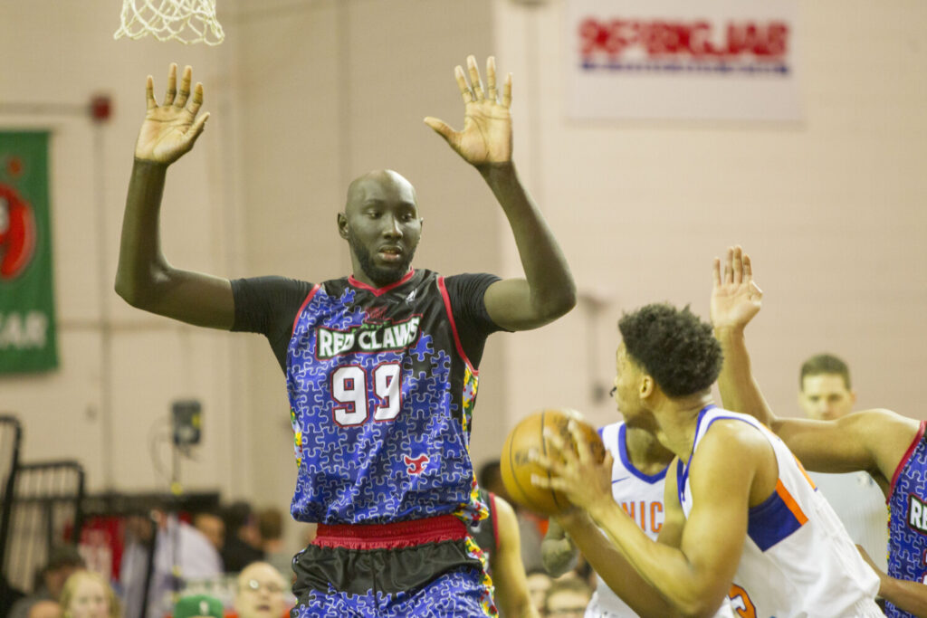 Tacko Fall of the Maine Red Claws defends a shot attempt by Ivan Rabb  of the Westchester Knicks on Friday at the Portland Expo.