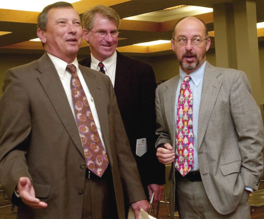 Augusta Mayor Bill Dowling, left, Maine Municipal Association Executive Director Chris Lockwood, center, and Augusta City Manager Bill Bridgeo respond to a comment from Maine Municipal Association President Bruce Benway in 2001 prior to the opening meeting of the agency's annual conference at the Augusta Civic Center.