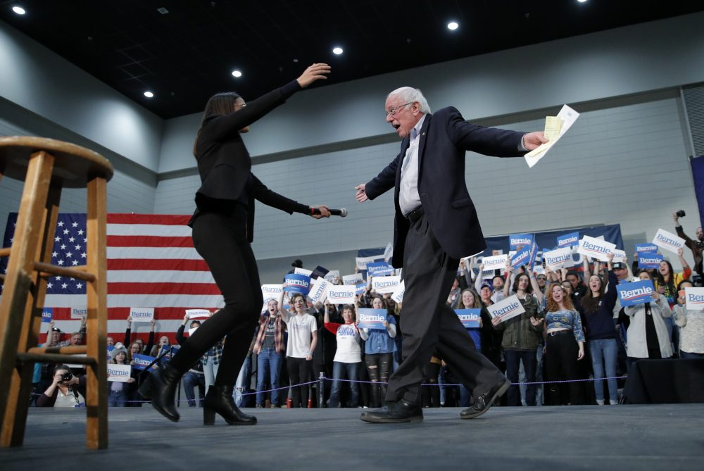 Democratic presidential candidate Sen. Bernie Sanders, I-Vt., right, embraces Rep. Alexandria Ocasio-Cortez, D-NY, at a campaign rally Sunday in Sioux City, Iowa.