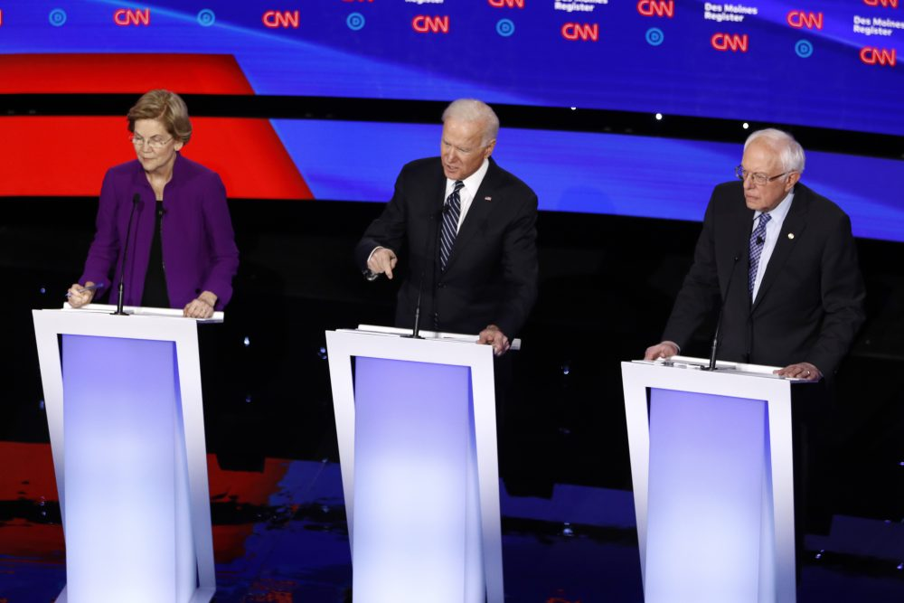 Democratic presidential candidates Sen. Elizabeth Warren, D-Mass., from left, former Vice President Joe Biden and Sen. Bernie Sanders, I-Vt., on stage, Tuesday, during a Democratic presidential primary debate in Des Moines, Iowa.