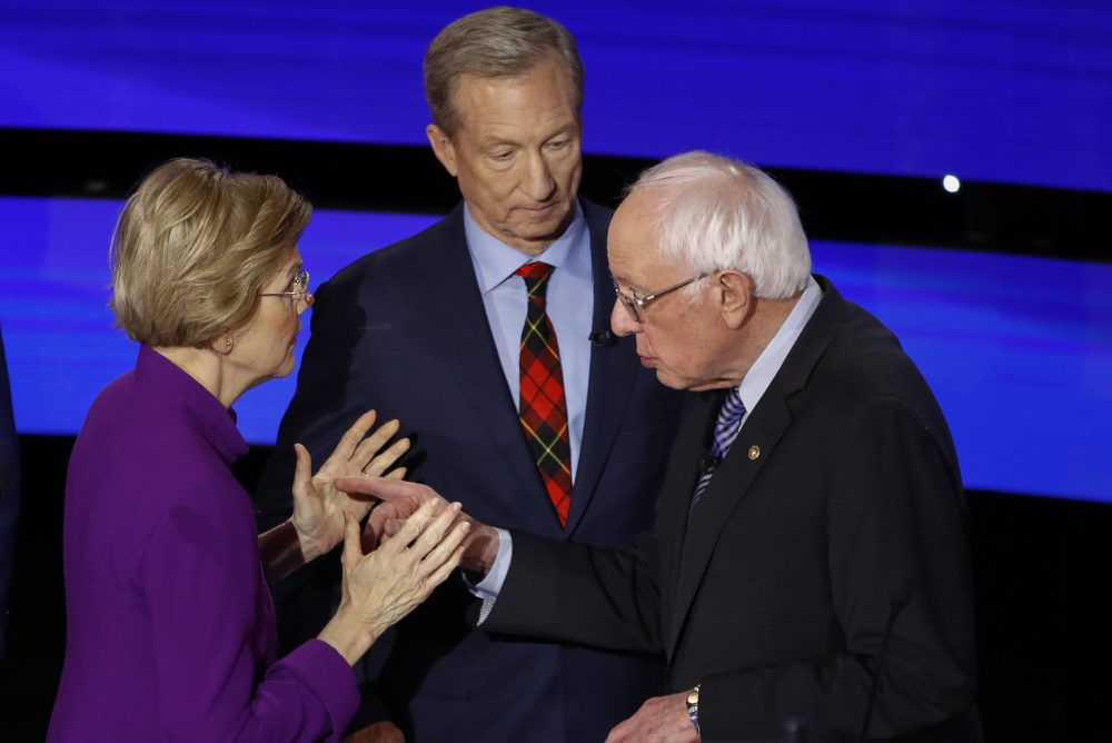 Democratic presidential candidates Elizabeth Warren and Bernie Sanders have a tense exchange after Tuesday's Democratic presidential primary debate. Warren accused Sanders of calling her a liar during the televised debate.