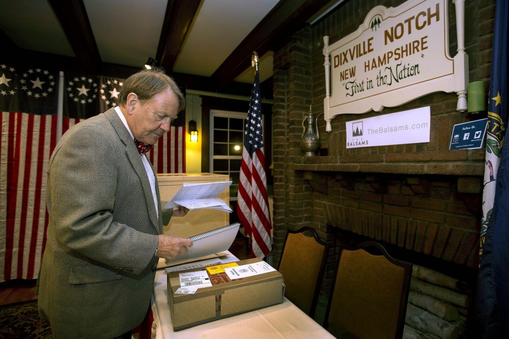 Town moderator Tom Tillotson arrives with ballots as voters get ready to cast their votes just after midnight in Dixville Notch, N.H., in November 2016.