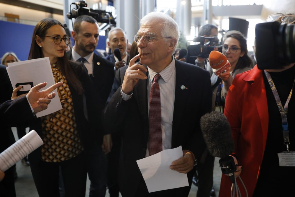 European Union foreign policy chief Josep Borrell is surrounded by reporters at the European parliament on Tuesday in Strasbourg, France. Britain, France and Germany have launched action under the Iran nuclear agreement paving the way for possible sanctions in response to Tehran's attempts to roll back parts of the deal, Borrell said.