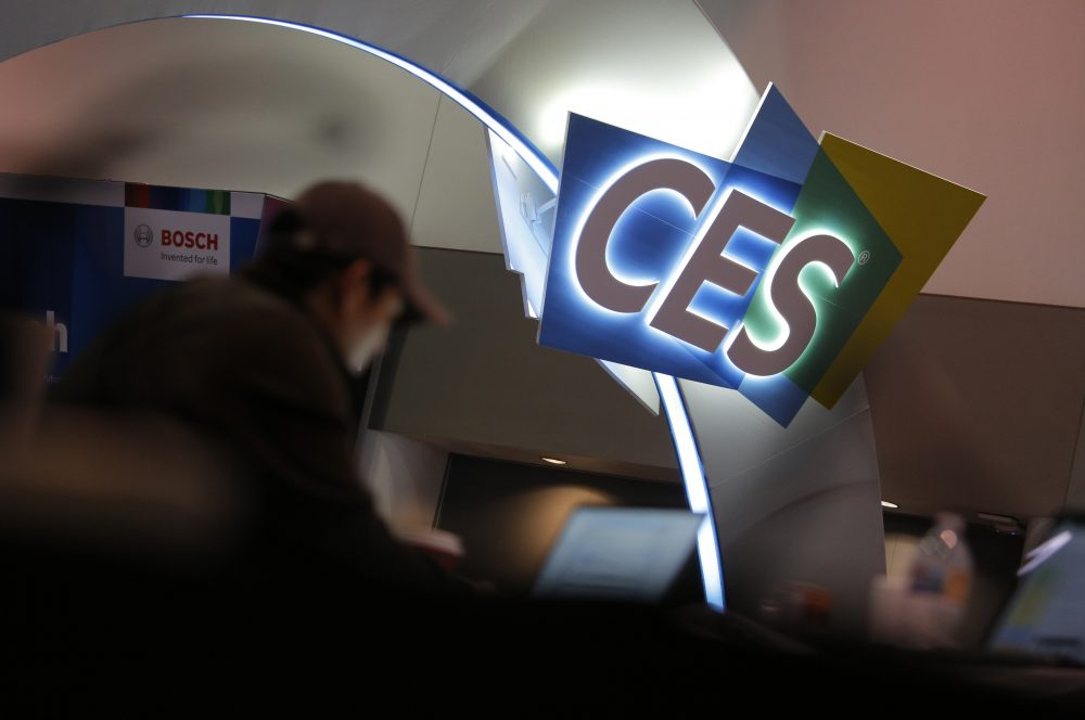 A worker helps set up a booth Saturday before CES International in Las Vegas.
