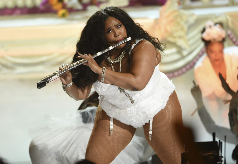 This June 23, 2019 file photo shows Lizzo playing the flute at the BET Awards in Los Angeles.
