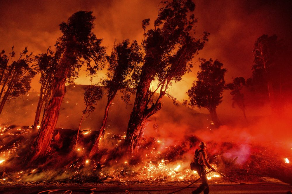In this Nov. 1, 2019, file photo, flames from a backfire consume a hillside as firefighters battle the Maria Fire in Santa Paula, Calif. The decade that just ended was by far the hottest ever measured on Earth, capped off by the second-warmest year on record, NASA and the National Oceanic and Atmospheric Administration reported Wednesday.