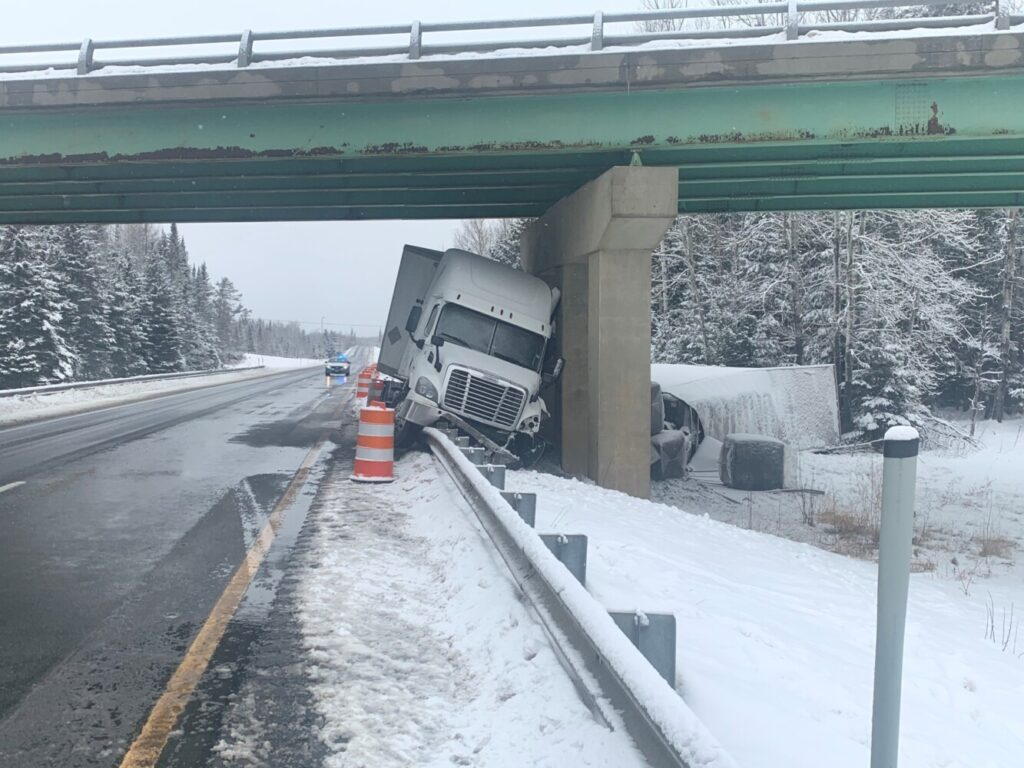 State police say this truck slid along about 100 yards of guardrail before hitting the bridge support on Interstate 95 in Aroostook County on Saturday.