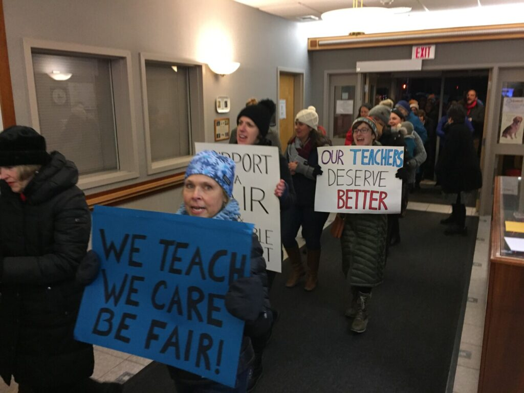 Chanting and carrying signs, Scarborough teachers stream into the municipal building during a school board meeting Thursday night to rally over stalled contract talks.