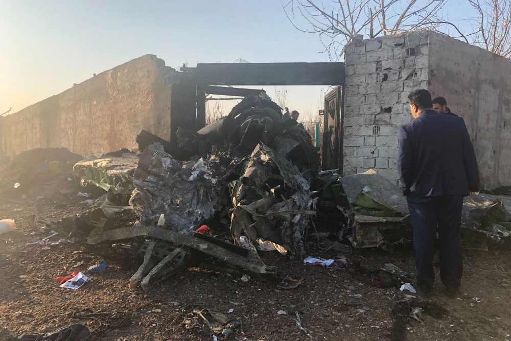 Debris from a plane crash is seen on the outskirts of Tehran, Iran, on Wednesday. A Ukrainian airplane carrying at least 170 people crashed shortly after takeoff from Tehran's main airport, killing all on board, state TV reported.