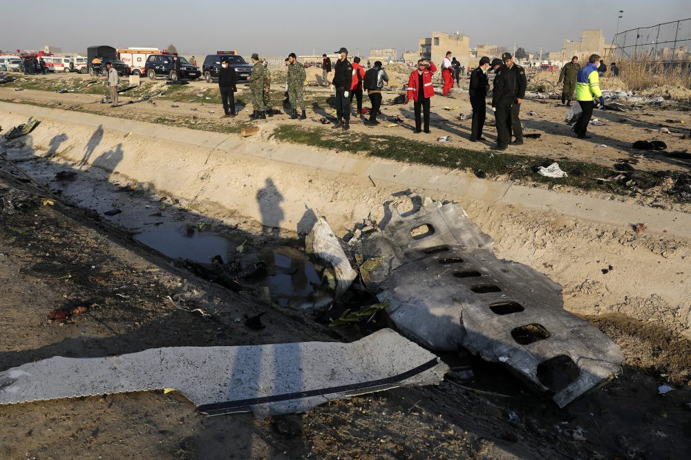 """Debris from an Ukrainian plane which crashed as authorities work at the scene in Shahedshahr, southwest of Tehran. Iran announced Saturday that its military """"unintentionally"""" shot down the Ukrainian jetliner that crashed earlier this week, killing all 176 aboard."""