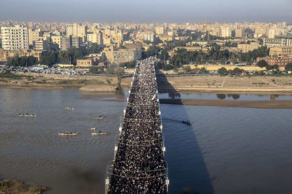 An aerial view shows mourners attending a funeral ceremony for Gen. Qassem Soleimani and his comrades, who were killed in Iraq in a U.S. drone strike, in the southwestern city of Ahvaz, Iran on Sunday. The body of Gen. Qassem Soleimani arrived Sunday in Iran to throngs of mourners, as President Trump threatened to bomb 52 sites in the Islamic Republic if Tehran retaliates by attacking Americans.