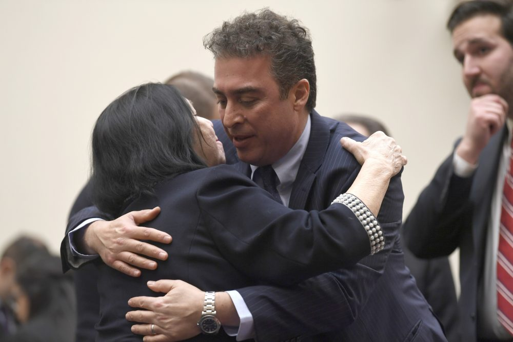 Christine Levinson, left, wife of Robert Levinson, a former FBI agent who vanished in Iran in 2007, gets a hug from Babak Namazi, the son of Baquer Namazi, who has been held in Iran, following their testimony before a House Foreign Affairs Subcommittee on Capitol Hill in Washington in March 2019. The killing of a top Iranian general has ratcheted up the anxiety of families of Americans held in Iran.