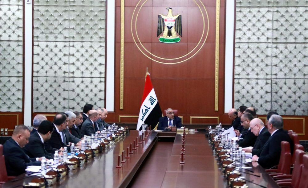 Iraqi acting Prime Minister Adil Abdul-Mahdi, center, heads a Cabinet meeting at the prime minister's office, in Baghdad, Iraq, on Tuesday. Abdul-Mahdi said the United States must withdraw its troops from Iraq.