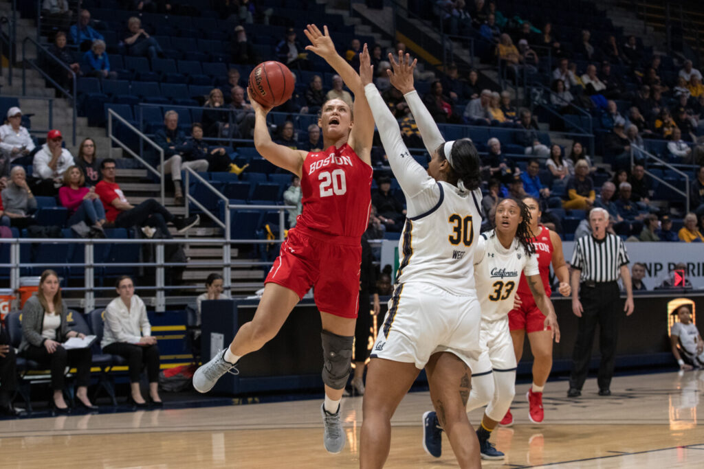 Boston University forward and Lawrence graduate Nia Irving goes up for a shot during a Dec. 7 game against the California Golden Bears in Berkeley, California. Irving recently scored her 1,000th point with the Terriers.
