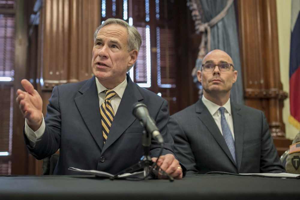 In this June 21, 2019 file photo, Gov. Greg Abbott, left, said the state would reject the resettlement of new refugees, becoming the first state known to do so under a recent Trump administration order.  Governors in 42 other states have said they will consent to allowing in more refugees, according to the Lutheran Immigration and Refugee Service.(Jay Janner/Austin American-Statesman via AP, File)