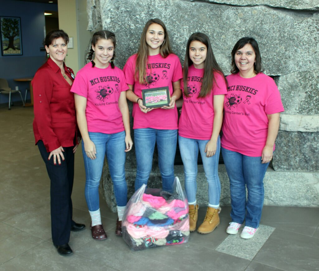 Maine Central Institute Huskies Varsity Girls Soccer Team recently presented a check and knit hats to Brenda Farnham, MBA, BSN, RN, OCN, manager of nursing services, Northern Light Cancer Care. From left are Farnham, with students Kayla French, Danielle Dow, Katelyn French and Laurie Logiodice.