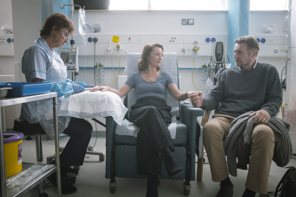 "Lesley Manville (center) as ""Joan"" and Liam Neeson (right) as ""Tom"" in directors Lisa Barros D'Sa and Glenn Layburn's ORDINARY LOVE, a Bleecker Street release.  Credit : Aidan Monaghan / Bleecker Street"