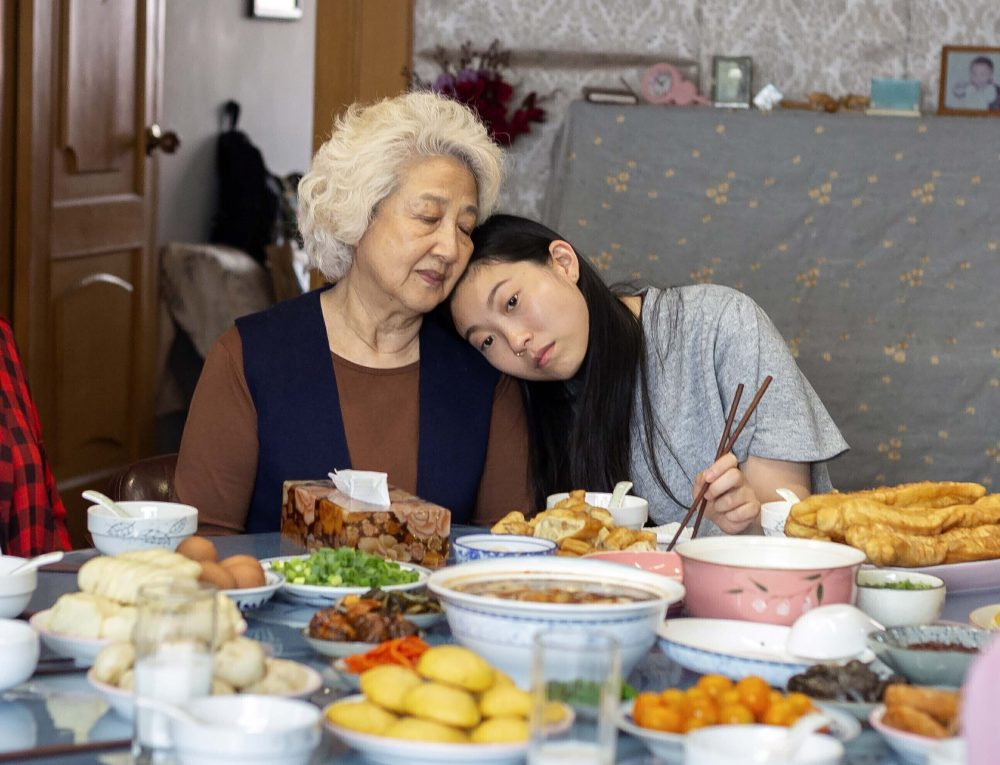"""This image released by A24 films shows Zhao Shuzhen, left, and Awkwafina in a scene from """"The Farewell."""" Awkwafina won a Globe earlier this month for """"The Farewell,"""" it was a proud moment for Asian Americans in Hollywood - the first win by an actress of Asian descent in the lead category. There was much hope for an Oscar nod, but alas, it was not to be; in fact the much-admired film was shut out."""