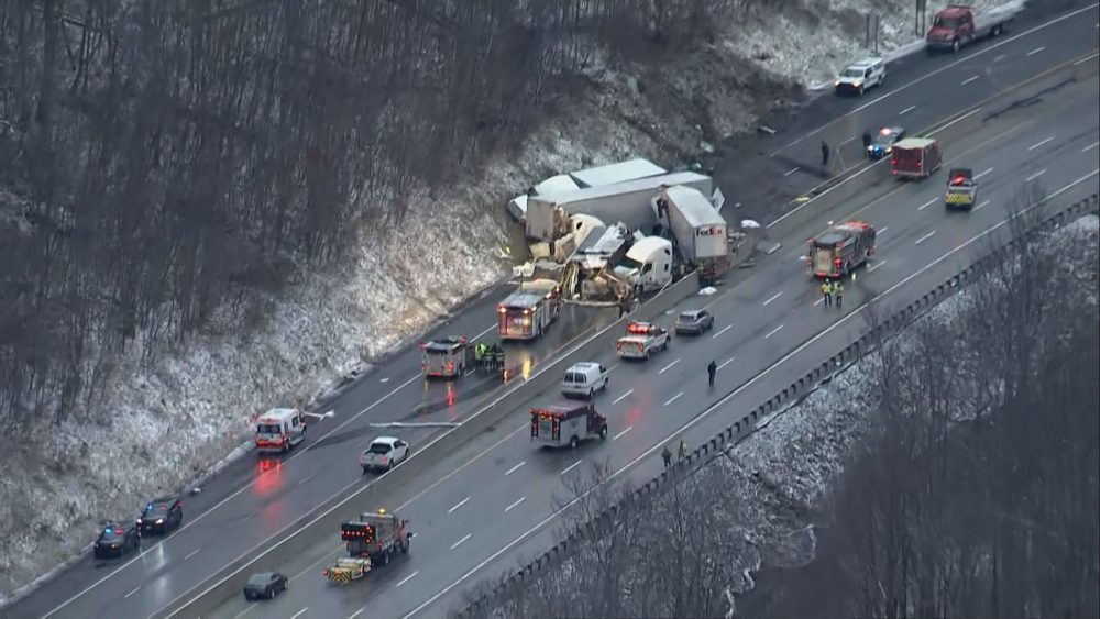 This image from video provided by KDKA TV shows the scene near Greensburg, Pa. along the Pennsylvania Turnpike where multiple people were killed and dozens were injured in a crash early Sunday.