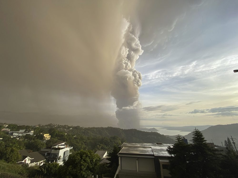 Plumes of smoke and ash rise from the Taal volcano on Sunday in Tagaytay, Manila, Philippines. Taal consists of multiple stratovolcanoes. Its primary feature is the three-mile-wide Volcano Island, which has 47 craters and sits in a lake.