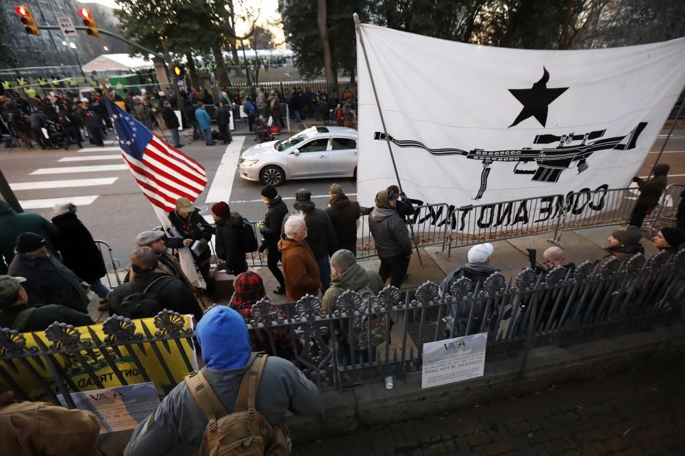 People line up outside the Capitol before a pro-gun rally on Monday in Richmond, Va.