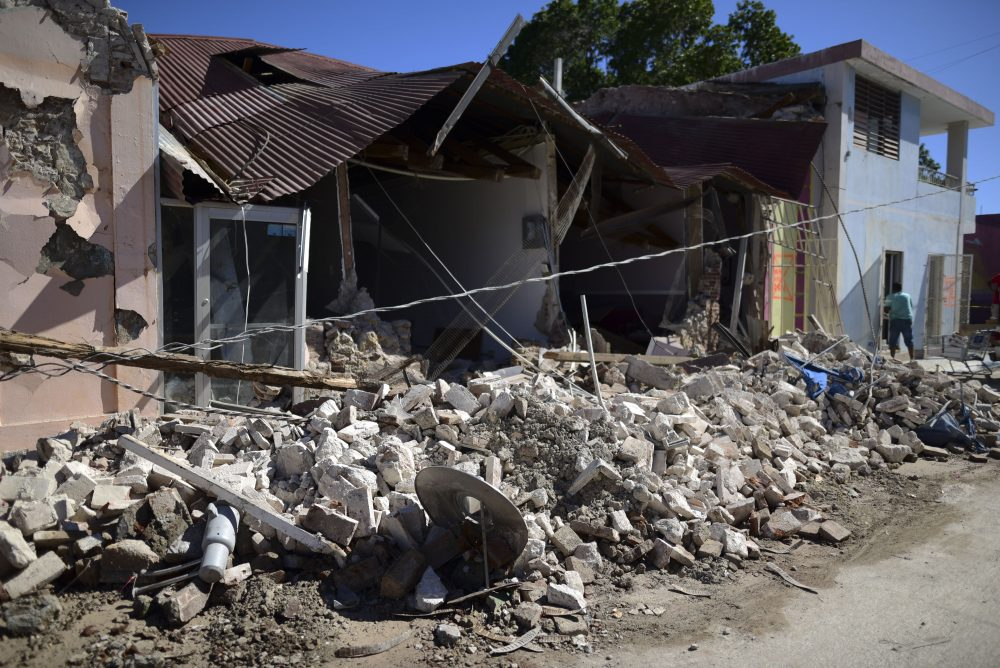 Homes are damaged after an earthquake struck Guanica, Puerto Rico, Tuesday, Jan. 7, 2020.