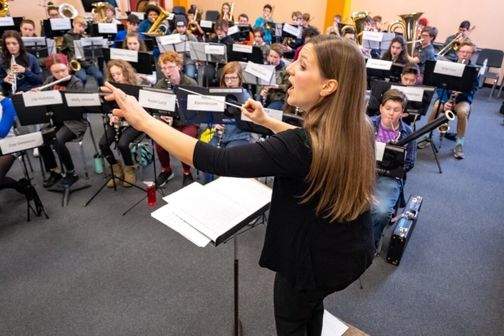 Krystle Smith from Westbrook Middle School conducts the middle school band during rehearsals Saturday during the District II Instrumental Festival at Oxford Hills Comprehensive High School in Paris. Roughly 300 musicians from 40 middle and high schools successfully auditioned to be part of either the orchestras or bands.