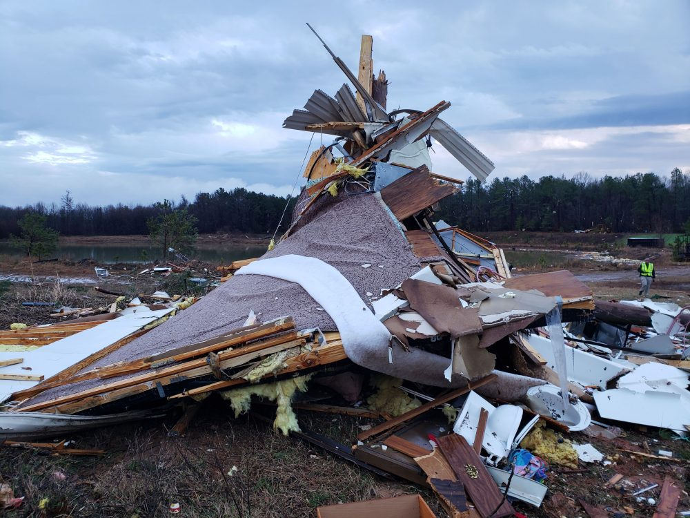 This photo provided by Bossier Parish Sheriff's Office shows damage from Friday night's severe weather, including the home of an elderly in Bossier Parish, La., on Saturday. The Bossier Parish Sheriff's Office said that the bodies of an elderly couple were found Saturday near their demolished trailer by firefighters.